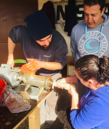 Pressing the sobrasada into the intestinal lining.